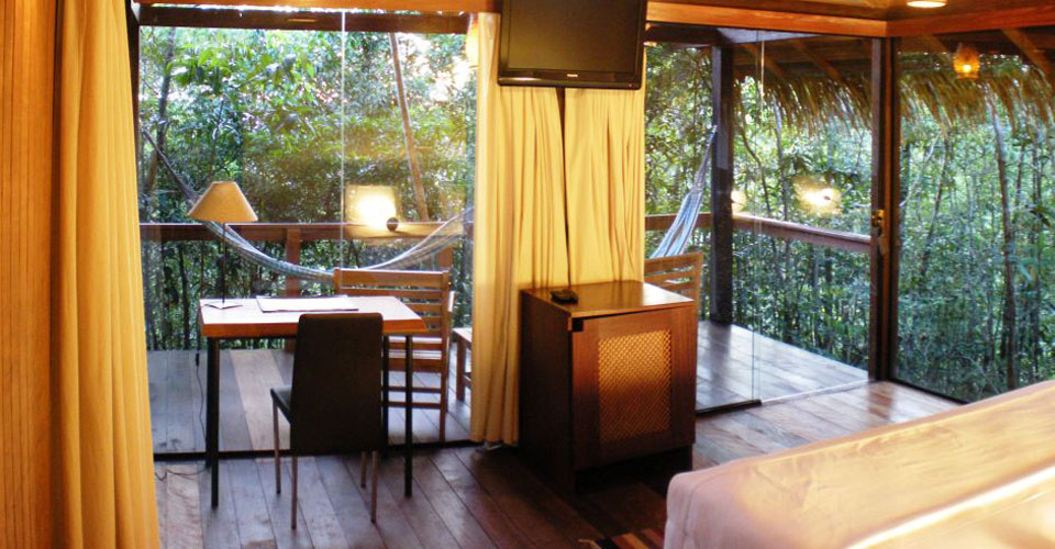 Bedroom and jungle view at the Anavilhanas Lodge in Amazon, Brazil