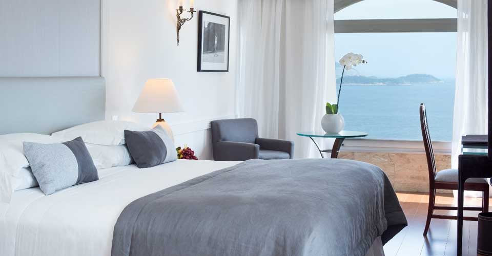 King size bed and ocean view from the Hotel Caesar Park by Sofitel in Rio de Janeiro, Brazil