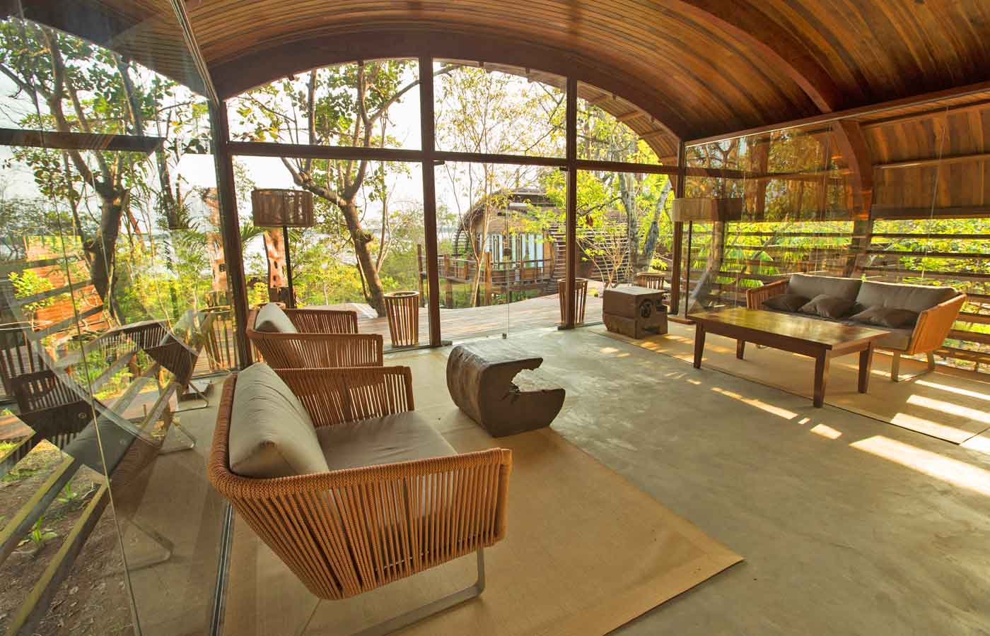 Wide arches of richly coloured wood blend with the surrounding forest at the Mirante-do-Gaviao in Amazonas, Brazil