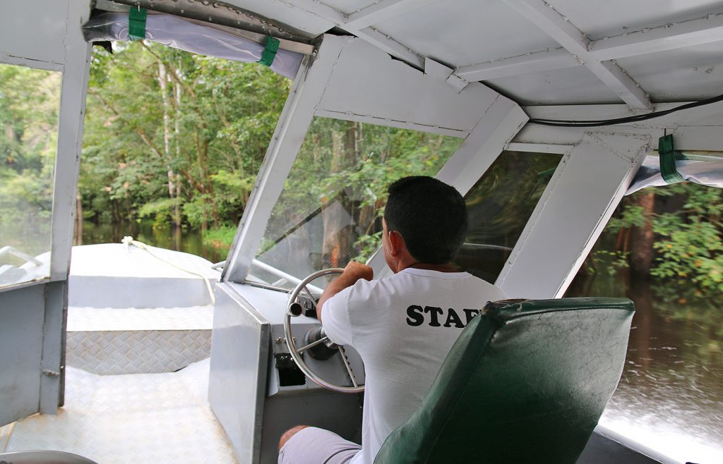 Our excellent driver steering us through the flooded forest.