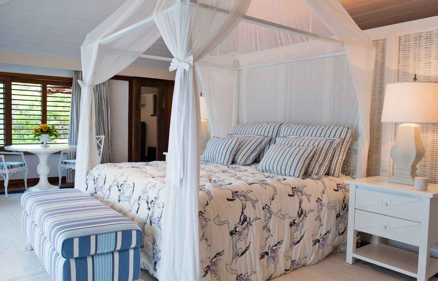 A designed suite decorated in traditional beach style with neutral decor at Pousada Tutabel , Trancoso , Bahia in Brazil