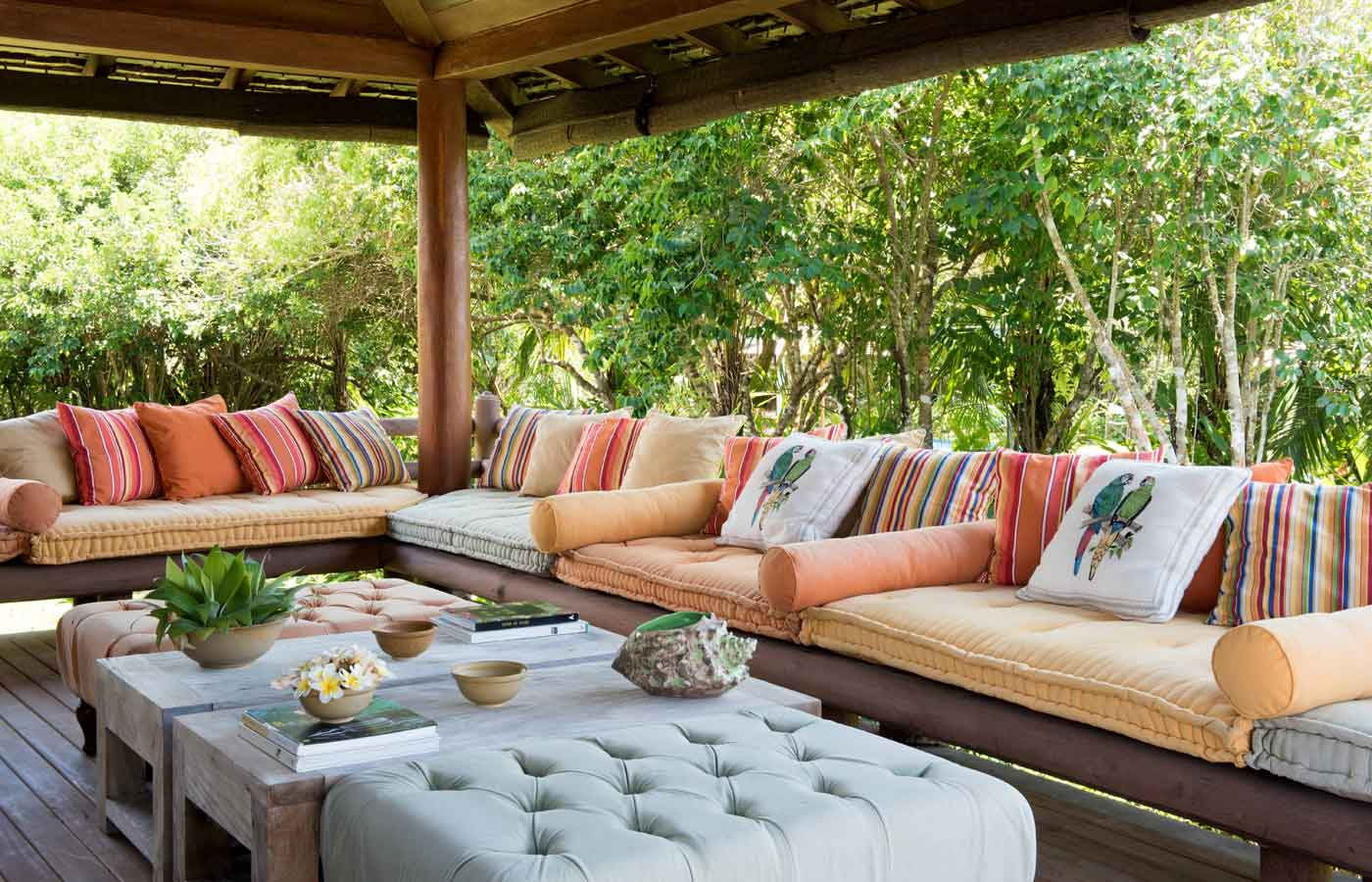 A shared outdoor seating area perfect for relaxation at Pousada Tutabel in Trancoso, Bahia, Brazil.