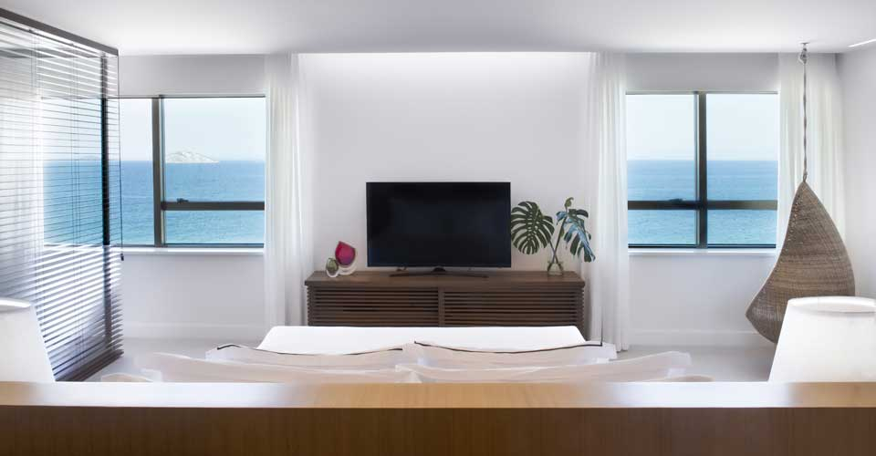 beach view from a modern bedroom at the Janeiro Hotel, Rio de Janeiro in Brazil