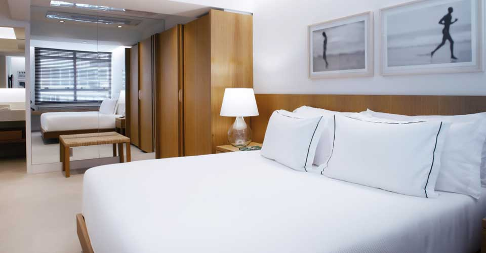 Modern, clean and minimalist bedroom at Janeiro Hotel, Rio de Janeiro in Brazil