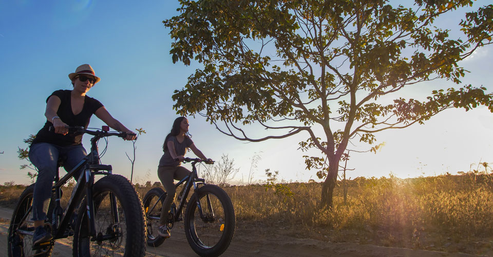 Biking in the savannah is one of the activities available at Trijuncao